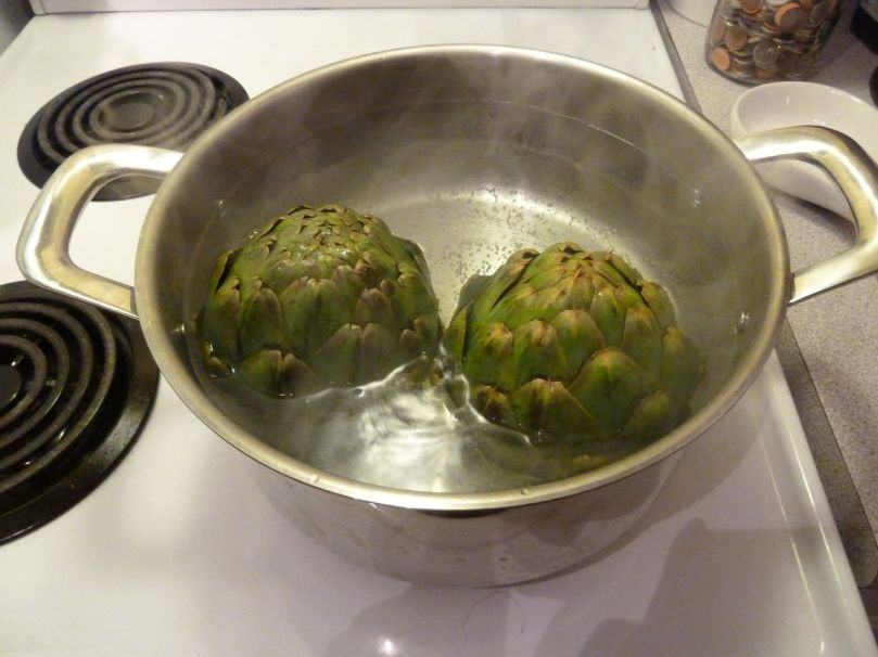 Plop your artichokes into that boiling water.